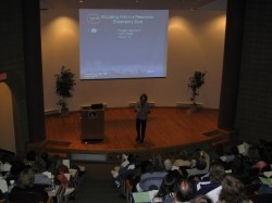 Photo of Christine Speaking in an Auditorium
